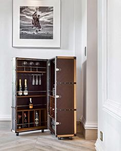 The traveler cocktail cabinet makes for a delightful bar. Adorned in leather, this is a truly luxury cocktail bar.
