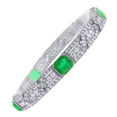 Art Deco Emerald Diamond Platinum Bracelet. A classic example of the Art Deco style this extraordinary bracelet boasts five vivid green emerald cut emeralds weighing 8.38 carats and 215 round diamonds weighing 4 carats, set in platinum. Measuring 73/8 long and 5/16 wide.