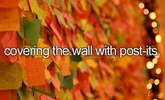 Covering the wall with post-its.