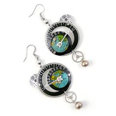 """All Around the World Earrings. Composed of a variety of vintage pocket watch components and globe segments, the earrings pay tribute to world travel. The reclaimed clockwork components are layered in hoops, accented with silver-plate arrows and surgical steel ear-wires.. With a style that is part steampunk, part eclectic, and part traditional, the """"All Around the World"""" earrings will be appreciated by world travelers and history buffs of all ages!"""