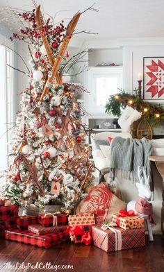 Flocked Ski Christmas Tree - fun ski themed Christmas tree decor featuring vintage skis, ski ornaments and snow balls.