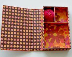 Van een oud boek een doos maken! altijd handig :)
