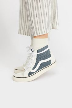 Sk8-Hi Reissue Vintage High Top Sneaker | **Fit:** This style is in unisex sizing so a men's size 4.5 is a women's size 6. Timelessly classic kicks, these Vans Sk8-Hi sneakers feature a high-top silhouette that effortlessly lace-up. Sturdy rubber sole and cushioned liner for ultra-comfy wear. * Classic Vans side stripe * Two-tone canvas and suede design