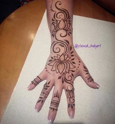 Lotus hand henna tattoo by STAINED