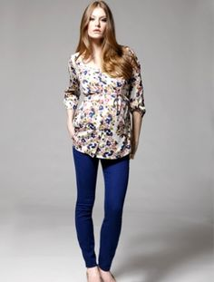 Floral shirt and blue pants (Jessica Simpson for Motherhood Maternity) www.thebump.com