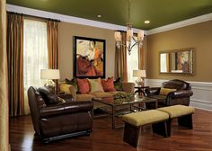 living room, family room, leather, chair, club, seating, table lamp, glass, bench, traditional, transitional, hardwood, drape, sheer, orange, green, neutral, lighting, chandelier, ceiling treatment, color, art, mirror