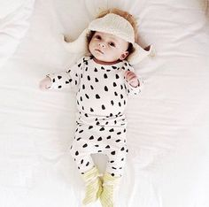 organic cotton onesie in black dot print by ourlittlelullaby