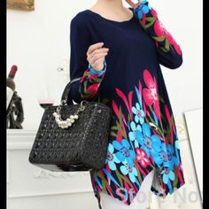 """Soft Black Floral Asymmetrical Sweater Black Floral Asymmetrical Sweater Soft & Stretchy! Design goes all the way around to the back of the sweater, so you will look lovely coming AND going! Bust-42"""" Hips-44"""" Length (shortest)-32"""" Length (longest)-35"""" Sleeve Length (from armpit)-21"""" Sweaters"""