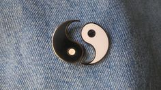 Do you have a yin to your yang? A best friend? A soul mate that completes you? Get the yin yang friendship pin set to rep your other half! Both pins come together. Details: Hard Enamel  Silver colored metal  1 inch  Butterfly backing  (secondary colors are in glitter)