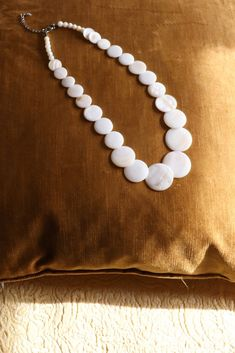 Vintage round shell necklace in cream white. Flat shell beads have a beautiful pearlized finish. Tavistock, Shell Necklaces, Shells, Pearl Necklace, Pearls, Vintage, Green, Accessories, Jewelry