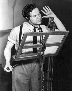The master of the radio play - Orson Welles. His classic War of the Worlds: http://www.youtube.com/watch?v=W6YNHq1qc44