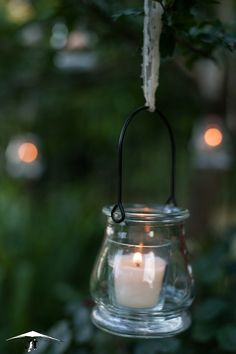 Pretty party lighting idea - candles hanging with lace from trees Photographer: https://www.facebook.com/tandemflightphotography