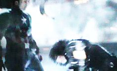 This takes place after Steve and Bucky have fought over the stick thing and Steve breaks Bucky's arm trying to get it. After that happens Bucky is holding his arm tightly to his chest, so it obviously hurt him. Then he begins to try and kill Steve. He is punching him with his metal arm, but he is holding him tightly down with his broken arm. He was trained so long to be a machine he didn't even allow himself to feel pain because he had to carry out his mission