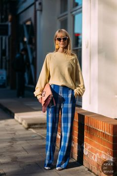 camel sweater and plaid pants