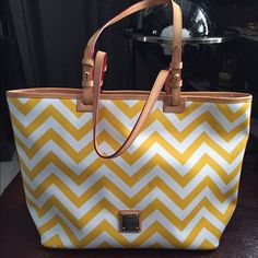"""Dooney&Bourke chevron leisure shopper handbag H11.5""""xW6.5""""xL14"""" one inside zip pocket. Two inside pockets. Cell phone pocket. Inside key hook. Strap drop length 10.5"""" zipper closure. Lined. Feet.  Dust bag not included, only one defect is sitting in my closet and somehow get two marks as shown on first pic around the D&B logo. Hardly noticeable, otherwise is perfect! fell free to use offer button. Welcome to any questions!  Dooney & Bourke Bags Totes"""