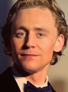 Those beautiful blue eyes. And those perfect lips. And that curly blonde hair. Cheekbones. Neck.