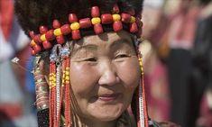 Mongolian woman in traditional dress.  Photograph: Dave G Houser/Corbis