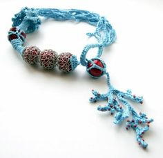 freeform crochet necklace jewelry sea insoired coral turquoise - love the wrapped beads (pebbles?), the simple loop closure & the variable width tube; all seen before but like this combo.