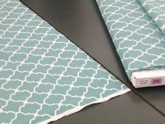 Three yards of Stella and Dot patterned material found at Hobby Lobby. The perfect table cloth for my display!