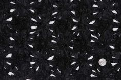 Black 01 Floral Novelty  Product #:	FP26362  Price:  	$35.00/Yard  This is a heavier weight novelty fabric made from taffetta flowers sewn together.  Content:	Polyester-100%  Country:	Imported  Width:	52""""
