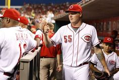 Cincinnati Reds starting pitcher Mat Latos (55) gets fist bump from Cincinnati Reds manager Dusty Baker (12) as he heads to the clubhouse after pitching seven innings and the win the Cleveland Indians at Great American Ball Park.