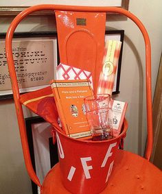 Orange wine bucket with chair.