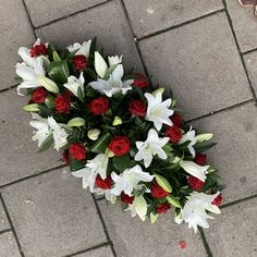 Red rose and white lily coffin spray funeral flowers tribute wreath, Funeral Flower Arrangements, Funeral Flowers, Sympathy Flowers, White Lilies, Rose Bouquet, Coffin, Red Roses, Lily, White Wreath