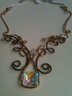 Crystal focal, wire wrap necklace with tri color wires.