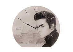 ELVIS OROLOGIO TAVOLO VETRO 25CM. Orologio da tavolo in vetro Elvis Presley regolabile da dietro, funziona con una batteria di tipo AA non inclusa