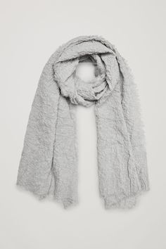 A tactile style, this scarf is made from stretch organic-cotton crepe with a crinkled texture and softly frayed edges. Grey Hat, Scarf Hat, Cotton Scarf, Layers Design, Crinkles, Summer Wardrobe, Womens Scarves, Wool Blend, Organic Cotton