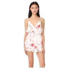 The Jetset Diaries Isabella Romper ($185) ❤ liked on Polyvore featuring jumpsuits, rompers, floral print, pink rompers, flower print romper, floral rompers, playsuit romper and pink floral romper