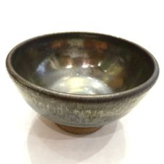 Wheel-thrown bowl with graphite grey glaze by SpinningSongPottery