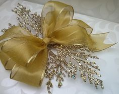 Beautiful gold organza wired ribbon gift bow with a glitter pick to make it extra special. Handmade to order.