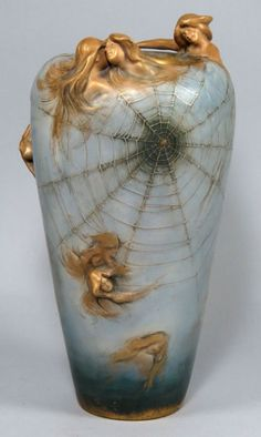 """ART NOUVEAU POTTERY VASE, AMPHORA bottom with raised profile mark, AMPHORA; also incised 3744 42  also red mark...TEPLITZ.RSK...Made in Austria reverse tapered form, pale blue glaze with gilt female figures raising from surface at rim and throughout, amidst spider web decoration, 14""""h"""