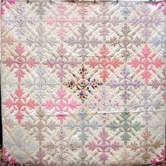"The quilt pattern is called ""Oak leaf and reel"" or sometimes just oak leaf. It was more common in the later 1800's when it was usually just red or blue on white, sometimes red & green on white. by vicky"