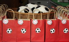 The favors were plush IKEA soccer balls for the little kids and a red paper bag with a water bottle, stickers, mini soccer balls and tattoos for the bigger kids. Each bag had a tag on it that said 'Good Game!'