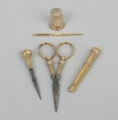 An Ivory Etui Necessaire Sewing Kit with French Vermeil Implements - Needle Threader is for pulling Elastic through Underwear!