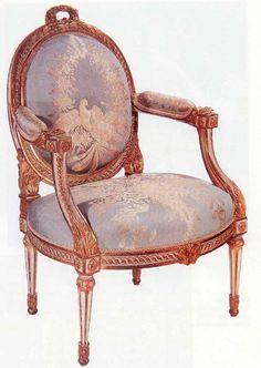 An armchair in Louis XVI style made of engraved, golden wood, Paris (1770 circa). Author: Jean Baptiste Gourdin