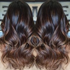 Dark brown balayage'd hair. But not as light of a brown at the bottom. And super shiny!!!