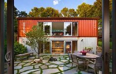 This two-story American Dream embraces its shipping container roots, as well.