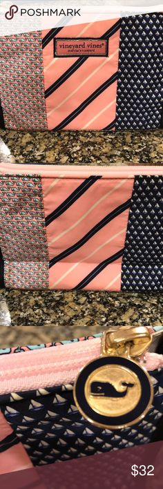 Vineyard vines make up bag/travel bag Adorable whale, sailboat and stripe print in pink, navy, light blue and white. Pink zipper. Lined in easy to clean plastic. Gold hardware. See last pic for tiny speck on bag Vineyard Vines Bags Travel Bags