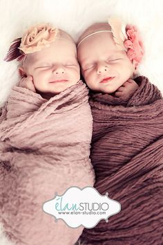 Newborn twins, swaddled