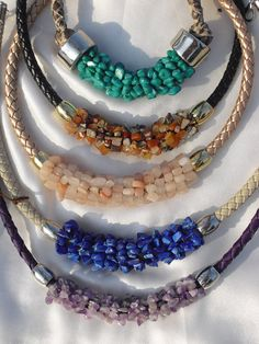 Necklace made by wrapping gemstone chips around a thick braided leather