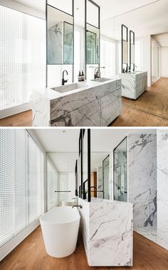 In this modern master bathroom, a double sink vanity is positioned in the center of the room, while a freestanding bathtub is located behind the vanity, and a full wall mirror makes the room feel…More Luxury Bathroom Master Baths, Modern Master Bathroom, Mirror Wall Living Room, Luxury Master Bathrooms, Free Standing Bath Tub, Mirror Wall Bathroom, Mirror Wall Bedroom, Bathroom Design, Bathroom Decor