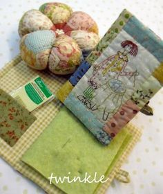 Love embroidery and quilting together.  Cute needle book and pincushion.