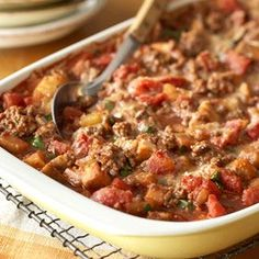 Moussaka - Eggplant, tomato, Parmesan cheese and ground beef are the heart of this fresh-tasting, easy version of a Middle Eastern dish. Serve with a tossed salad and hot, crusty bread. Might taste good with venison