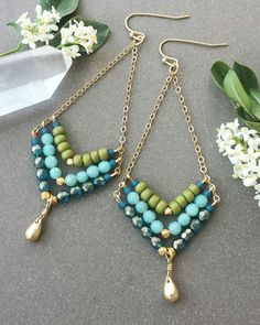 These boho style earrings are long, light, and lovely with gorgeous springtime blue and green tones. They feature faceted Amazonite gemstones with Azurite Halo firepolish and matte lemongrass seed beads, and faceted satin gold accents. The earrings measure a little over 3.75 long x 1.25