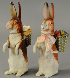 Two standing Easter rabbit candy containers, both with wicker baskets on their backs, glass eyes on the varnished one. Easter Candy, Hoppy Easter, Easter Parade, Bunny Art, Easter Crafts, Easter Decor, Candy Containers, Egg Art, Easter Holidays