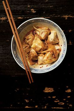 These wontons—a mix of ground pork, rice wine, garlic, ginger, and soy—are tossed in red chile oil before serving, adding the signature Sichuan heat.