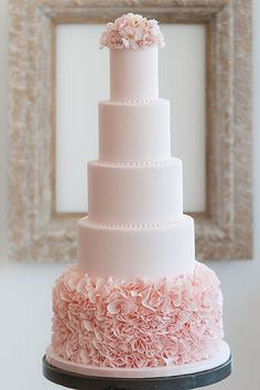 A statement blush wedding cake! I love the color but I think I'd like a little more detail on the tiers...maybe like some swirls or something... just to take off a bit of the plain look...